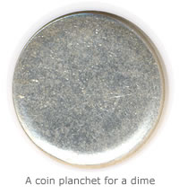 A regular coin planchet for a dime. Prior to the outer rim being raised, it's called a blank