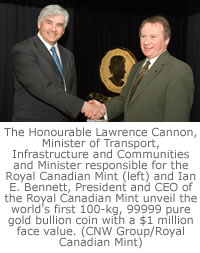 The Honourable Lawrence Cannon, Minister of Transport, Infrastructure and Communities and Minister responsible for the Royal Canadian Mint (left) and Ian E. Bennett, President and CEO of the Royal Canadian Mint unveil the world's first 100-kg, 99999 pure gold bullion coin with a $1 million face value. (CNW Group/Royal Canadian Mint)