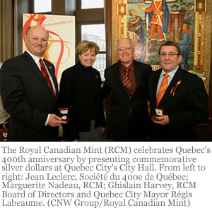 The Royal Canadian Mint (RCM) celebrates Quebec's 400th anniversary by presenting commemorative silver dollars at Quebec City's City Hall. From left to right: Jean Leclerc, Société du 400e de Québec; Marguerite Nadeau, RCM; Ghislain Harvey, RCM Board of Directors and Quebec City Mayor Régis Labeaume. (CNW Group/Royal Canadian Mint)