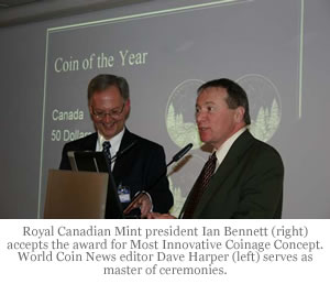 Royal Canadian Mint president Ian Bennett (right) accepts the award for Most Innovative Coinage Concept. World Coin News editor Dave Harper (left) serves as master of ceremonies.