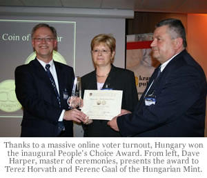 Thanks to a massive online voter turnout, Hungary won the inaugural People's Choice Award. From left, Dave Harper, master of ceremonies, presents the award to Terez Horvath and Ferenc Gaal of the Hungarian Mint.