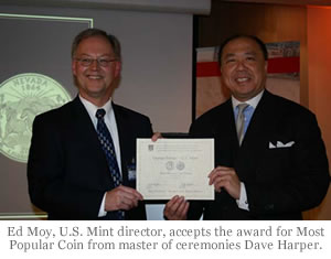 Ed Moy, U.S. Mint director, accepts the award for Most Popular Coin from master of ceremonies Dave Harper.