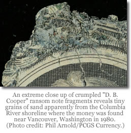 D.B. Cooper note close up showing tiny grains of sand