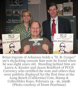 "Brian Ingram of Arkansas holds a ""D. B. Cooper"" 1971 skyjacking ransom $20 note he found when he was eight years old. Photo credit: Donn Pearlman"