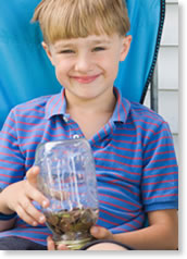 Child with jar of coins