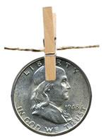 Franklin Half Dollar Hanging from Clothesline