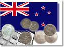New Zealand flag, calculator and silver coins