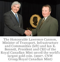 The Honourable Lawrence Cannon, Minister of Transport, Infrastructure and Communities and Minister responsible for the Royal Canadian Mint (left) and Ian E. Bennett, President and CEO of the Royal Canadian Mint unveil the world's first 100-kg, 99999 pure gold bullion coin with a $1 million face value. (2007. CNW Group/Royal Canadian Mint)