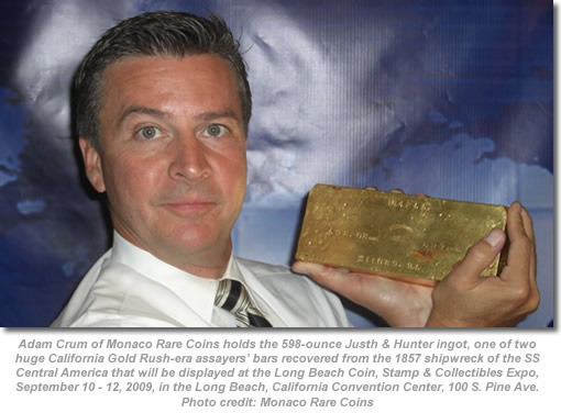 Adam Crum holds 598-ounce Justh & Hunter gold ingot
