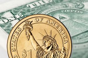 Dollar bill and $1 coin