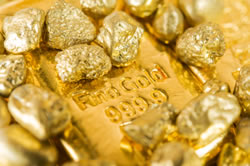 Gold nuggets and bar