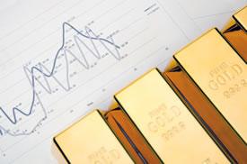 Charts and gold bars