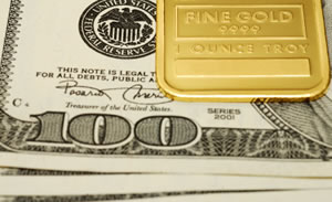Fine gold bar, US $100 bills