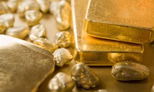 Three Gold Bullion Bars and Nuggets