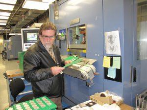 Lynn Lobb inspecting bullion product