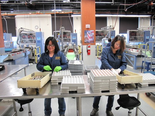 SF Mint Employees Racking Coin Blanks