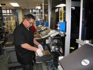 SF Mint employee operating packaging line