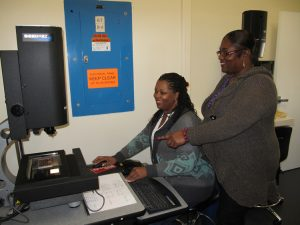 SF Mint employees operating inspection machine