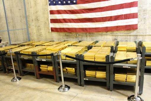 Gold Bars Stacked in Vault at West Point Mint, US Fag Above
