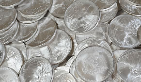 Mound of American Eagle silver coins