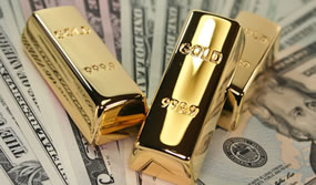 Three gold bars on US bills