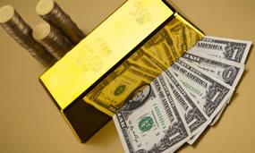 US bills, gold bar and coins