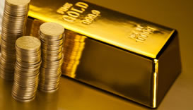 Gold bar and stack of gold coins