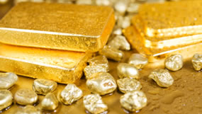 Four gold bars and nuggets
