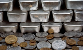 Silver bars, gold and silver coins