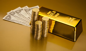 Coins, gold bar and US dollars