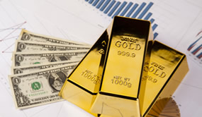 Three gold bars, five $1s and graphs