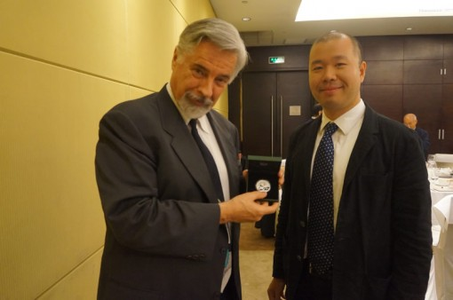 David Hall (holding 2014 Panda coin) and Rocky Zhou