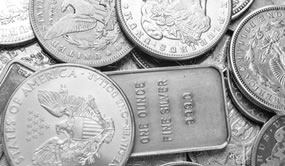 Gold, Silver Tumble on Week; US Mint Bullion Sales Slower
