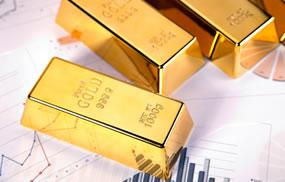 Three gold bars and chart