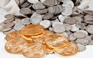Silver coins in bag and Gold Eagle bullion coins