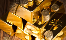 Stacks of gold bars and coins