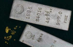 Two silver bullion bars and gold nuggets