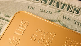 US Money and gold bar