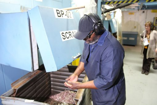 Freddie Smith Checking Scrap on Coin Production Floor, Denver Mint
