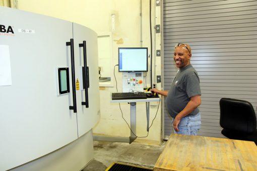 Sean Calhoun Operating Laser Serializer Machine at Denver Mint