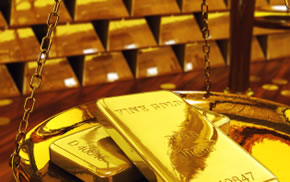 gold bars and scale weighing gold bars