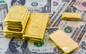US Dollars and Gold Bullion Bars