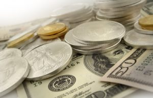 Gold Tumbles Most in 2014, US Mint Bullion Coin Sales Jump