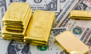 Gold bullion bars and US Money