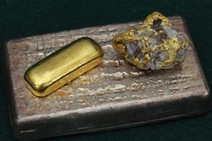 Large silver bullion bar, smaller gold bar and nugget