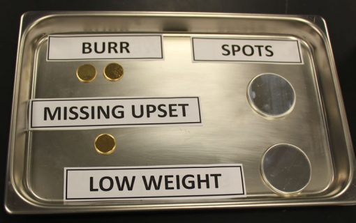 Examples of planchets with burrs, missing upset, spots and low weights