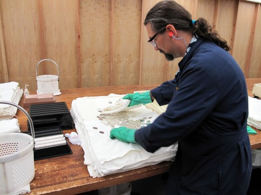 Ruvo demonstrates the preparation of blanks prior to the stamping process.