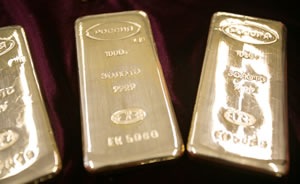 Three silver bullion bars