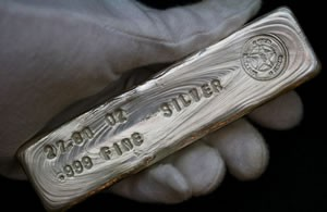 .999 fine silver bar held in hand