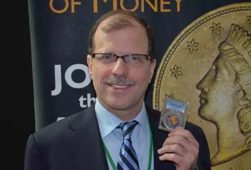 Brian Hendelson with 1879 Stella gold coin